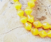 Cats eye bicoon geel/oranje