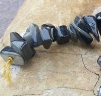 Nuggets schelp donker grijs/legergroen